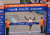 Meb Keflezighi crosses the finish line