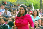Oprah stands in the audience