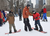 Receiving snowboarding instruction