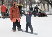 This young one is very excited to learn how to snowboard!