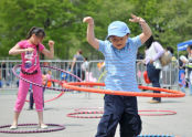 Kids hula hooping at Steet Games.