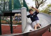 Taking the slide down Campanaro Playground