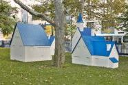 Village (2004), a group of plywood buildings , view 1