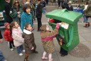 Children demonstrate their expert recycling skills