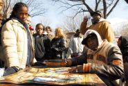 Rising hip hop star Jibbs signs autographs