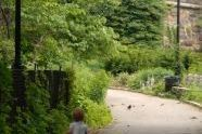 Child running through Fort Tryon Park