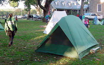 Urban Park Ranger and a tent