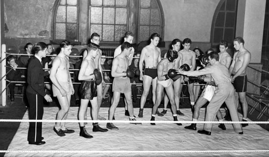 Amateur boxing lessons at the West 29th Street Gymnasium, December 11, 1941.  Courtesy of Parks Photo Archive, Neg. 21056.
