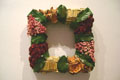 Madeline Yanni: Square Wreath, 2008. Bamboo, quince, cedar roses, larkspur, moss covered Styrofoam