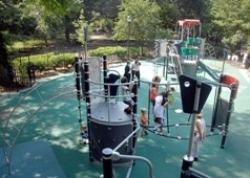 Neighborhood children enjoy the newly renovated Tompkins Square Park playground. The $1.5 million project installed new play equipment, safety surface, water features, and sandbox.
