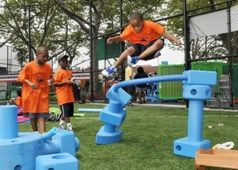 Campers in Brownsville play with  Imagination Playground's Loose Parts in 2008