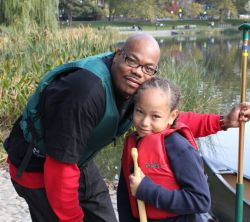 Darryl Harris and his son prepare to canoe on the Harlem Meer on October 24.