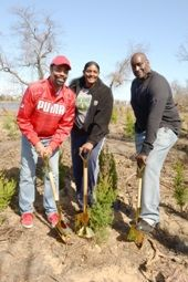 Walt 'Clyde' Frazier, Kym Hampton and Anthony Mason planting trees at Jamaica Bay Park;  Photo by Malcolm Pinckney