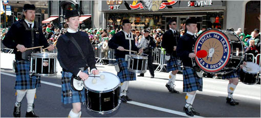 Drummers perform in kilts and traditional Irish clothing in parade