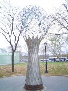 Tree trunk figure, globe constructed of a transparent matrix of coated rods with fittings at connecting points