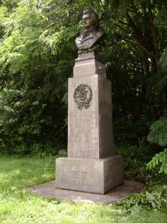 Bust (heroic scale) on pedestal decorated with applied wreath