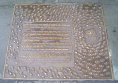 A series of 22 plaques set into the sidewalks surrounding park