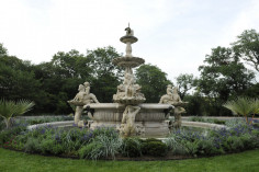 Three-tiered, octagonal fountain with extensive sculptural program of sea creatures, etc.
