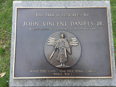 Relief plaque on plinth