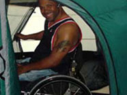 Camper enjoing a Wheelchair Accessible Tent