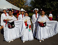 men and women posing in mexican costumes