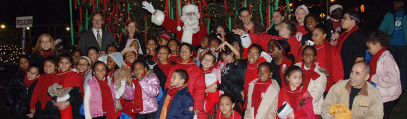 Santa posing with people at the Randall's Island tree lighting