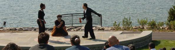 people performing a show on stage at waterfront park