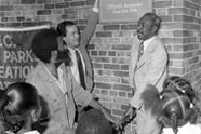 1978 groundbreaking ceremony for the rehabilitation and renaming of Colonial Park Recreation Center (now Jackie Robinson Recreation Center) in Manhattan. From left to right: David Robinson (son of Jackie Robinson), Commissioner Gordon J. Davis, and Councilman Fred Samuel.