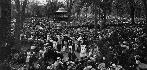 A 1910 shot of an orchestral concert on the Mall at Central Park. Neg. AR587