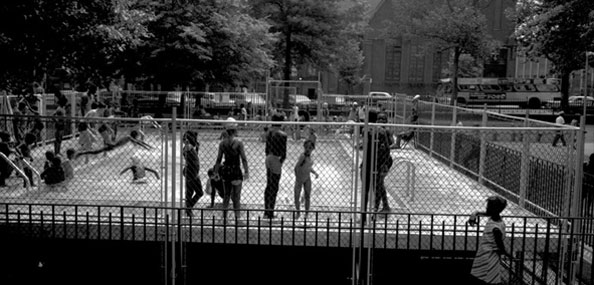 Image of Children swim in the Marcus Garvey Park portable pool on July 22, 1967. Neg. 32991.3.