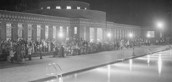 Image of The dramatic opening on Sunset Park Pool, complete with underwater lights. July 1936. Neg. 8859.
