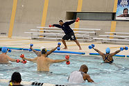 People participating in water aerobics