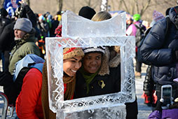 two people posing in an ice carved frame