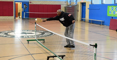 Person playing pickleball