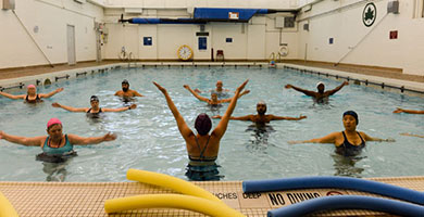 People doing aquatic exercise in an indoor pool