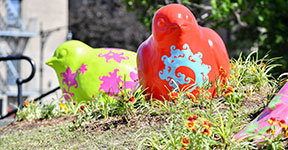 colorful brid sculptures with patterns in the park
