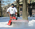 Work at Parks Maintenance and Operations - Parks maintenance worker clearing up snow in th parks for public safety