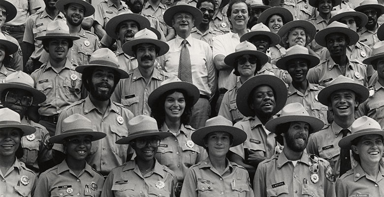 Archival image of the first class of park rangers, former parks commissioner Gordon J Davis, and Mayor Ed Koch
