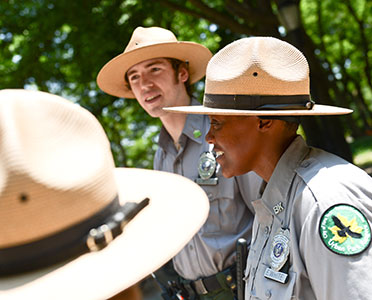 Park rangers chat among themselves