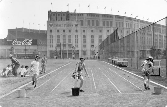 Image of Girls race at McCombs Dam Park, in front of Yankee Stadium, on February 10, 1947. Neg. 24977