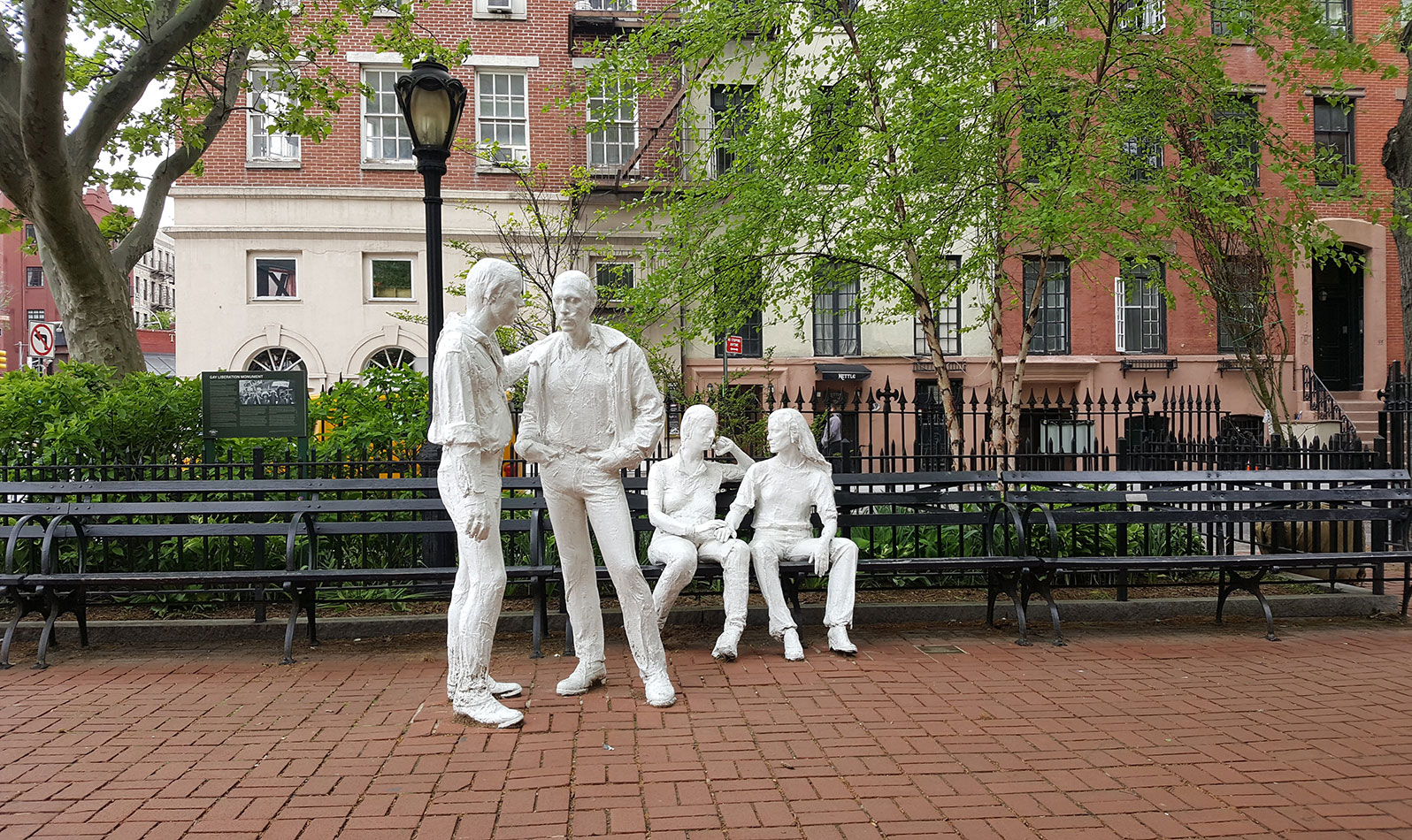 The Gay Liberation Monument, a historic LGBTQ site, features four figures - two standing males and two seated females - are positioned on the northern boundary of the park, in natural, easy poses.