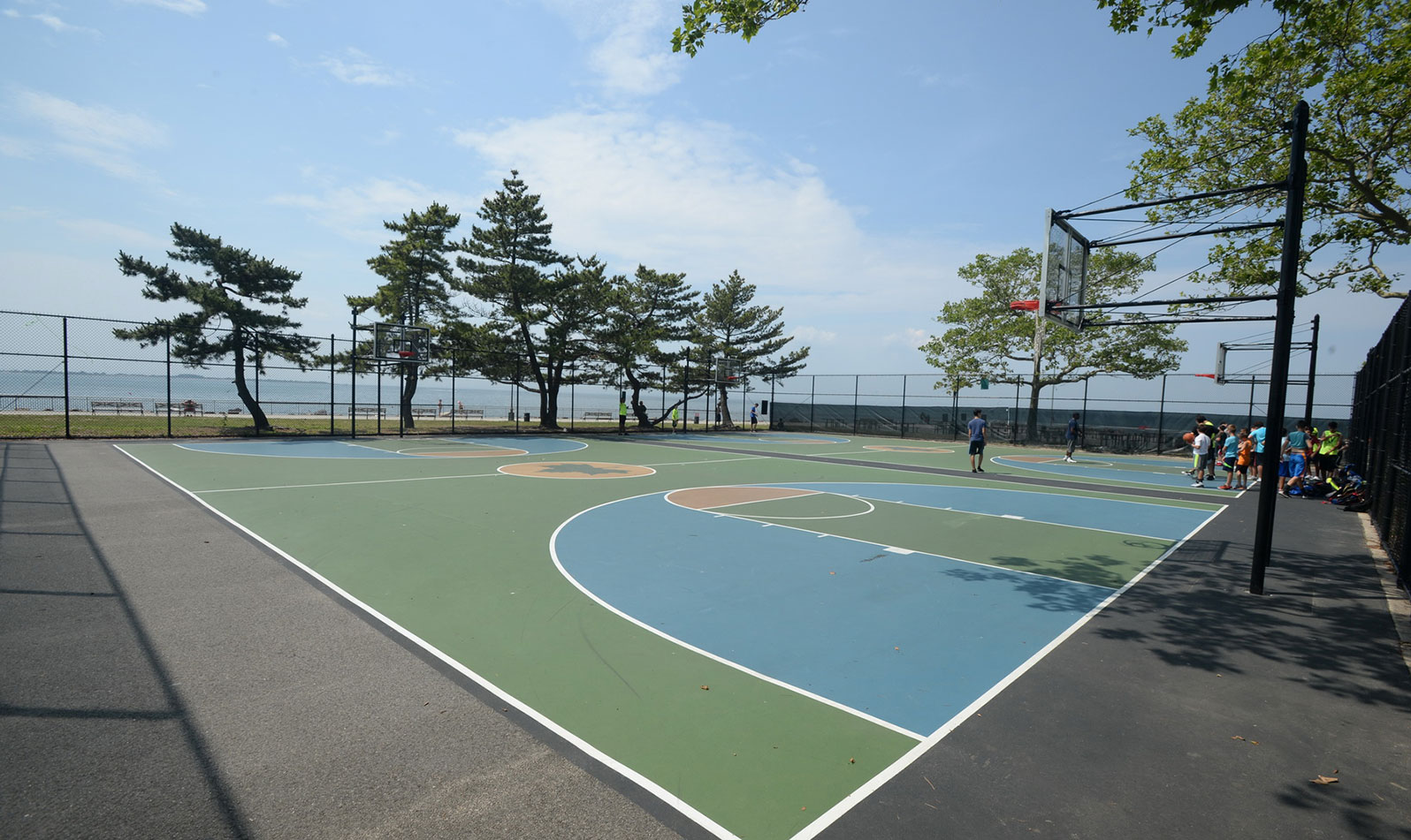 Play pick-up basketball games with the waterfront as your backdrop.