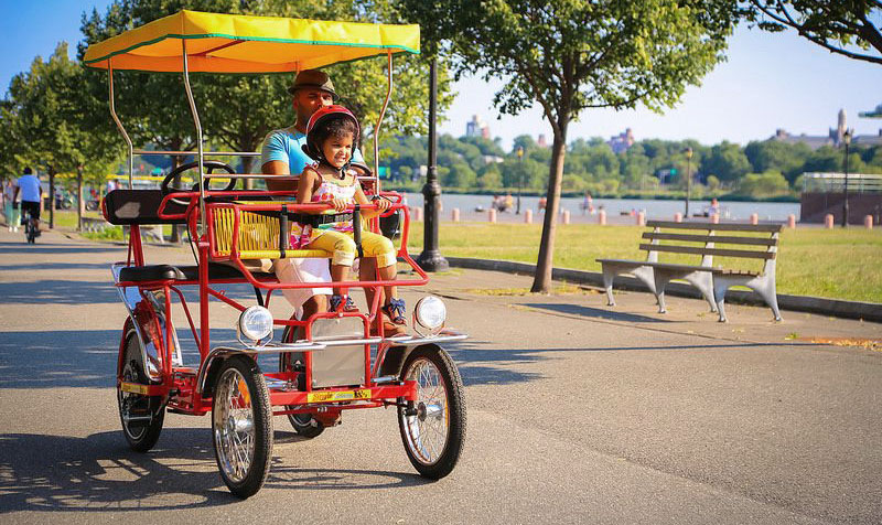 Take the kids for a ride around the park on a surrey, or take a boat out on Meadow Lake! (Photo credit: Wheel Fun Rentals).