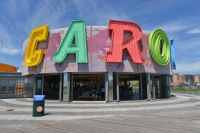 "The letters ""C-A-R-O"" are prominent on the whimsical B&B Carousell building on a sunny day.."
