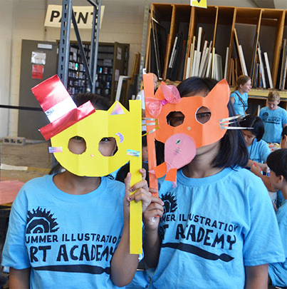 Kids in Summer Illustration Art Academy tshirts pose for pictures while wearing masks that they crafted.