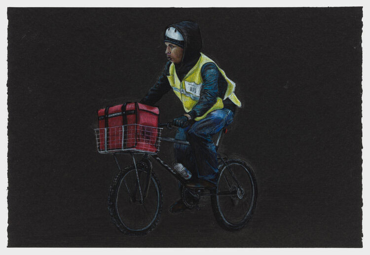 A delivery worker wears a yellow vest while riding between delivering food