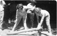 Girl Scouts cutting wood