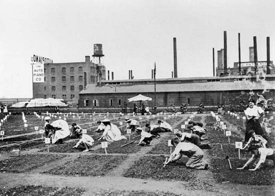 1908 Parks Annual Report image of children tending the De Witt Clinton Park Farm Garden.