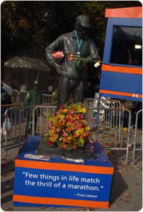 A statue of former NYRR President Fred Lebow awaits runners at the finish line to the New York City Marathon.