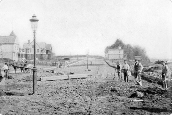 Image of Workers starting the extension of New York's Eastern Parkway around 1896. Olmsted & Vaux's tree–lined parkways incorporated nature into the plans for additional roads to accommodate increased population.